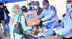 الشرطة تشارك في توزيع الطرود الغذائية في مخيم شعفاط بأورشليم القدس