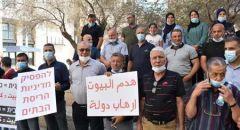 اهال من نحف يتظاهرون أمام المحكمة بسبب هدم المنازل