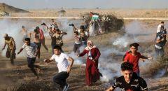 11 اصابة بينهم ثلاثة بالرصاص الحي خلال مواجهات محدودة في مهرجان الفصائل الفلسطينيه شرق خانيونس
