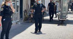 حيفا : الشرطة تعتقل امرأة اقتحمت بنك وهددت بتفجير حزام ناسف